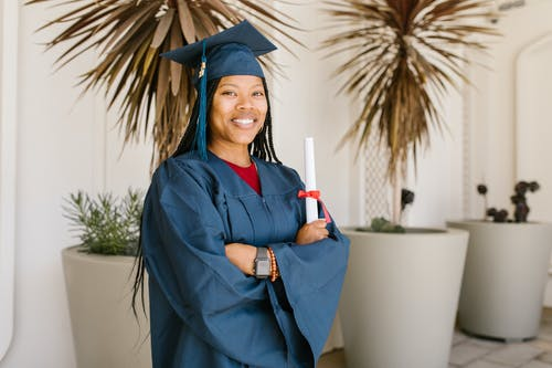 Smiling Woman in Blue Academic Gown