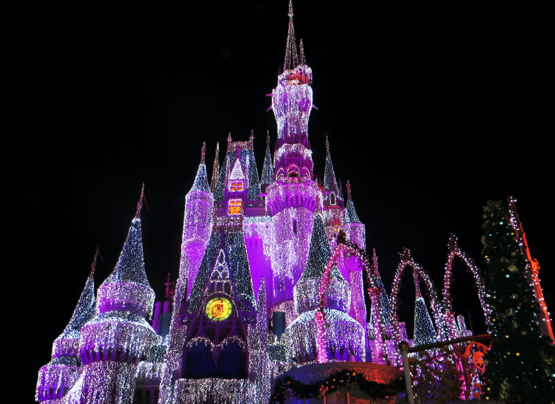 lighted Disney castle at night