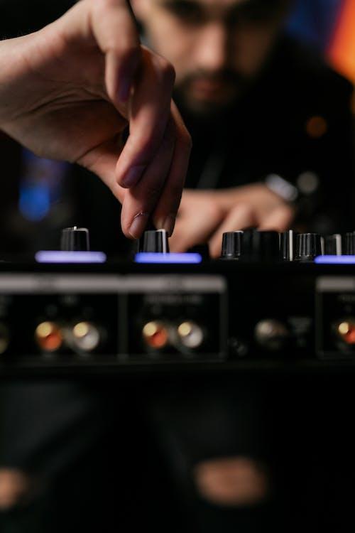 A Person Using an Audio Mixer