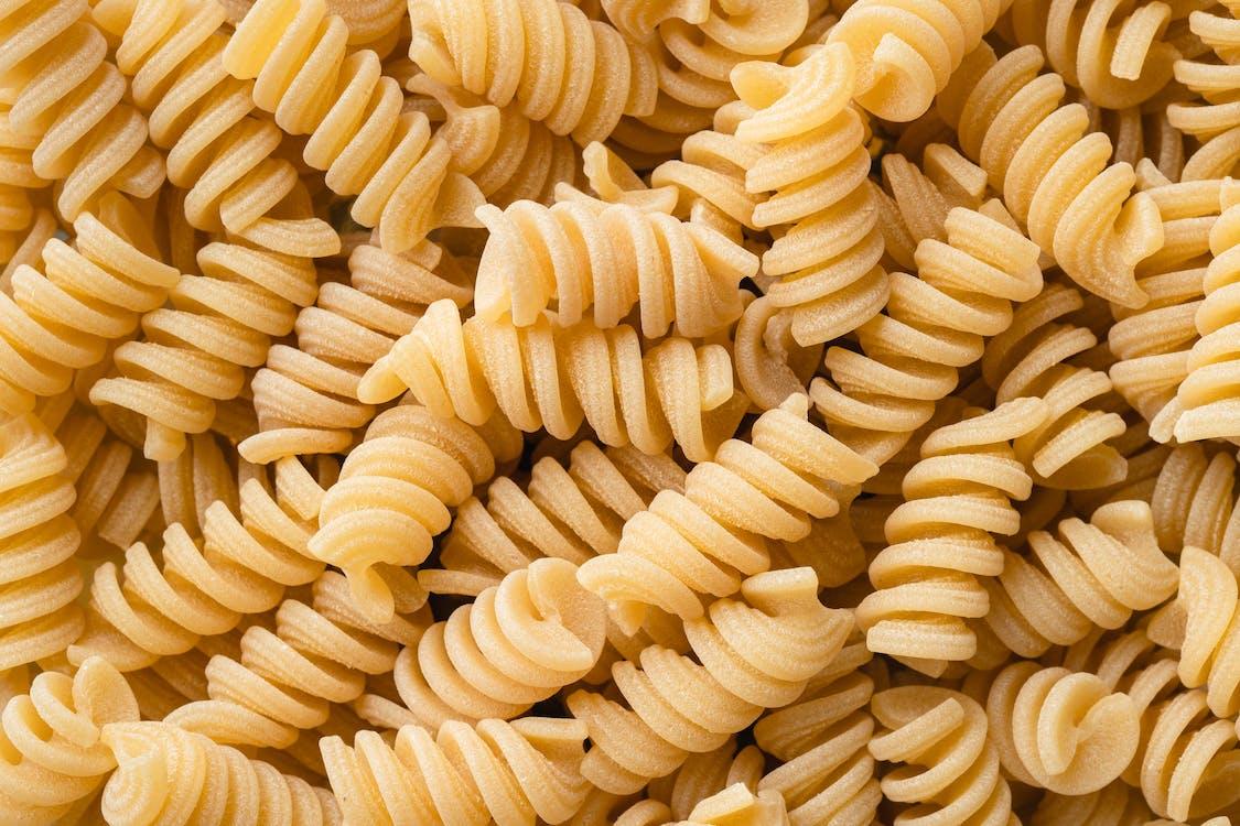 Yellow Pasta on Black Background