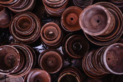 Top View Photo of Pile of Brown Round Clay Pots