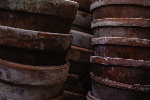 Close Up Photo of Pile of Brown Clay Pots