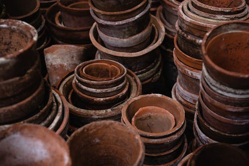 HIgh Angle Photo of Pile of Brown Round Clay Pots