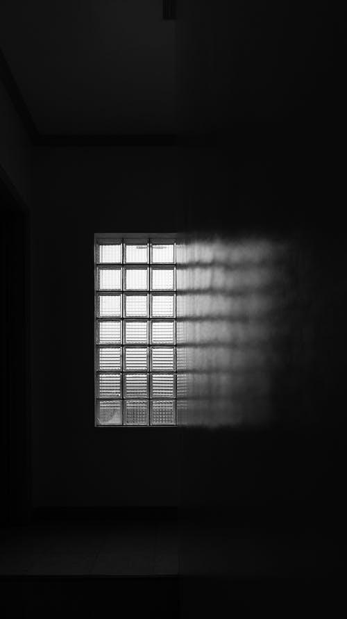 Photo of Glass Window on a Dark Room