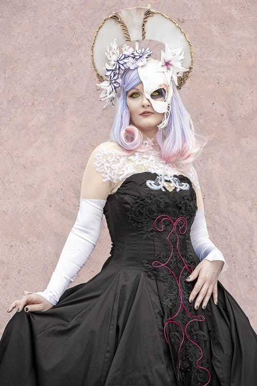 Woman in Black and White Long Sleeve Dress Wearing White Mask