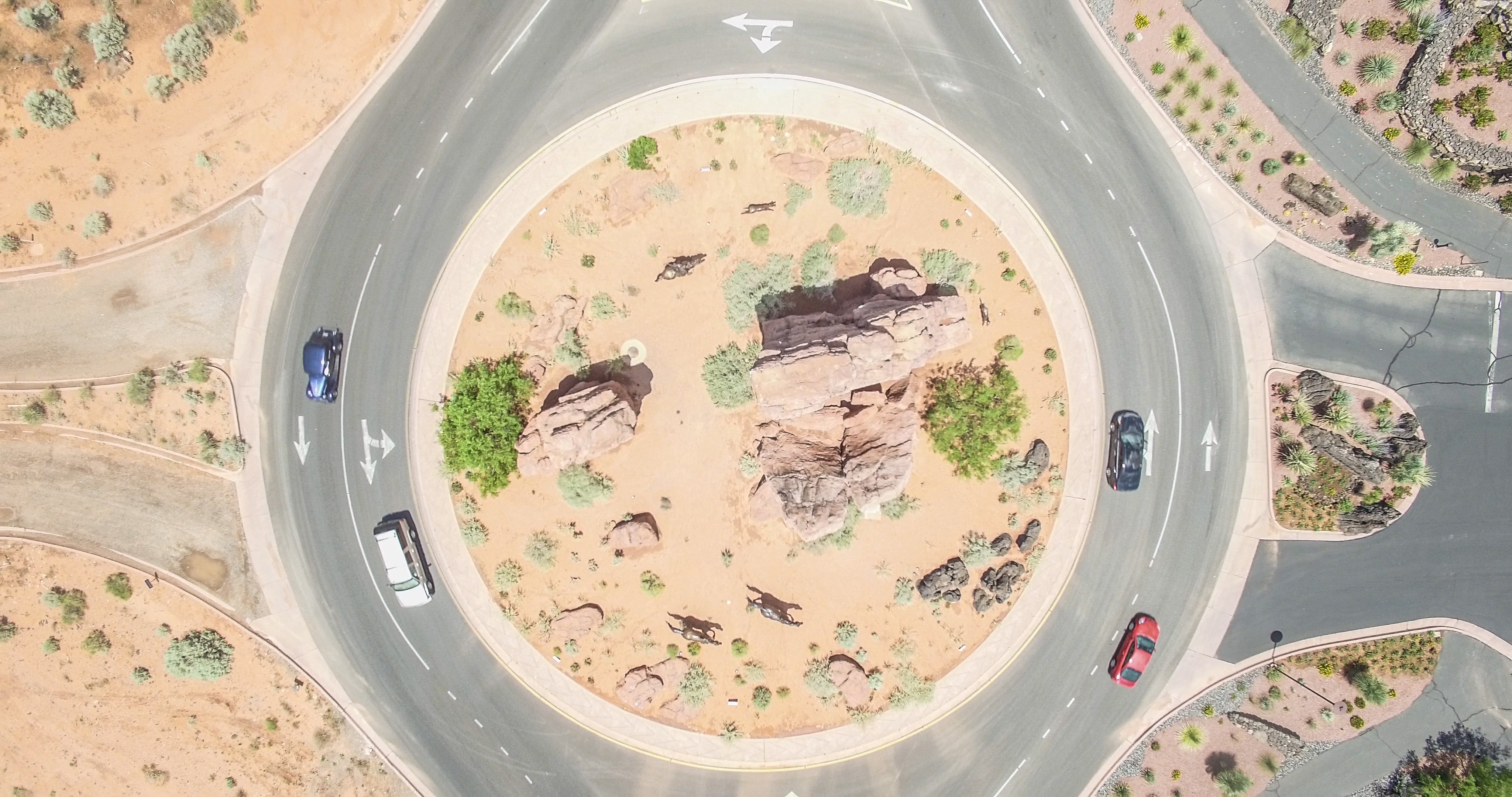 Aerial Photo of Four Cars on round about at Daytime