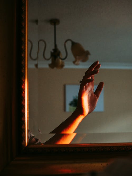 Person Doing Hand Sign Near Window