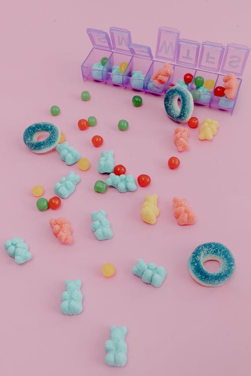 Pink Yellow and Blue Round Candies