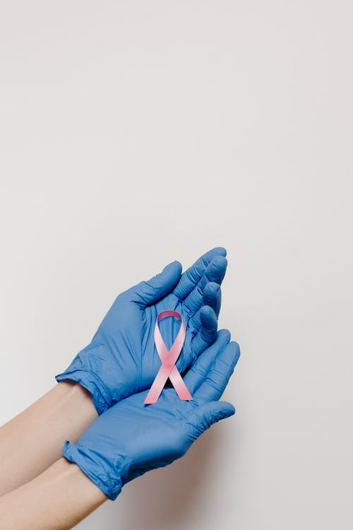 A Person Holding a Cancer Ribbon