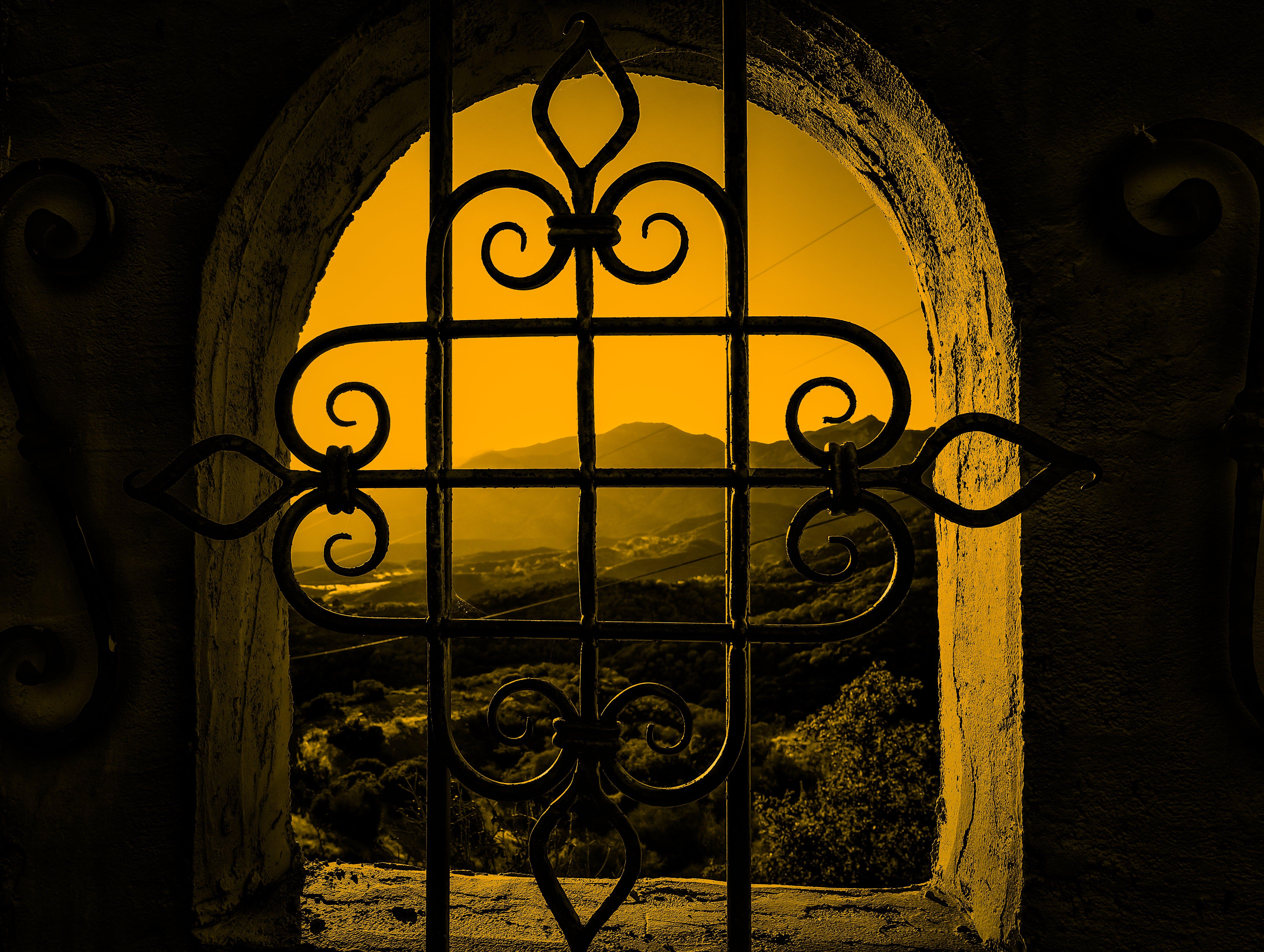 Free stock photo of Mountain view through a window
