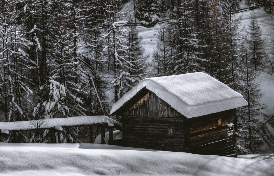 Brown Wooden Barn during Snow