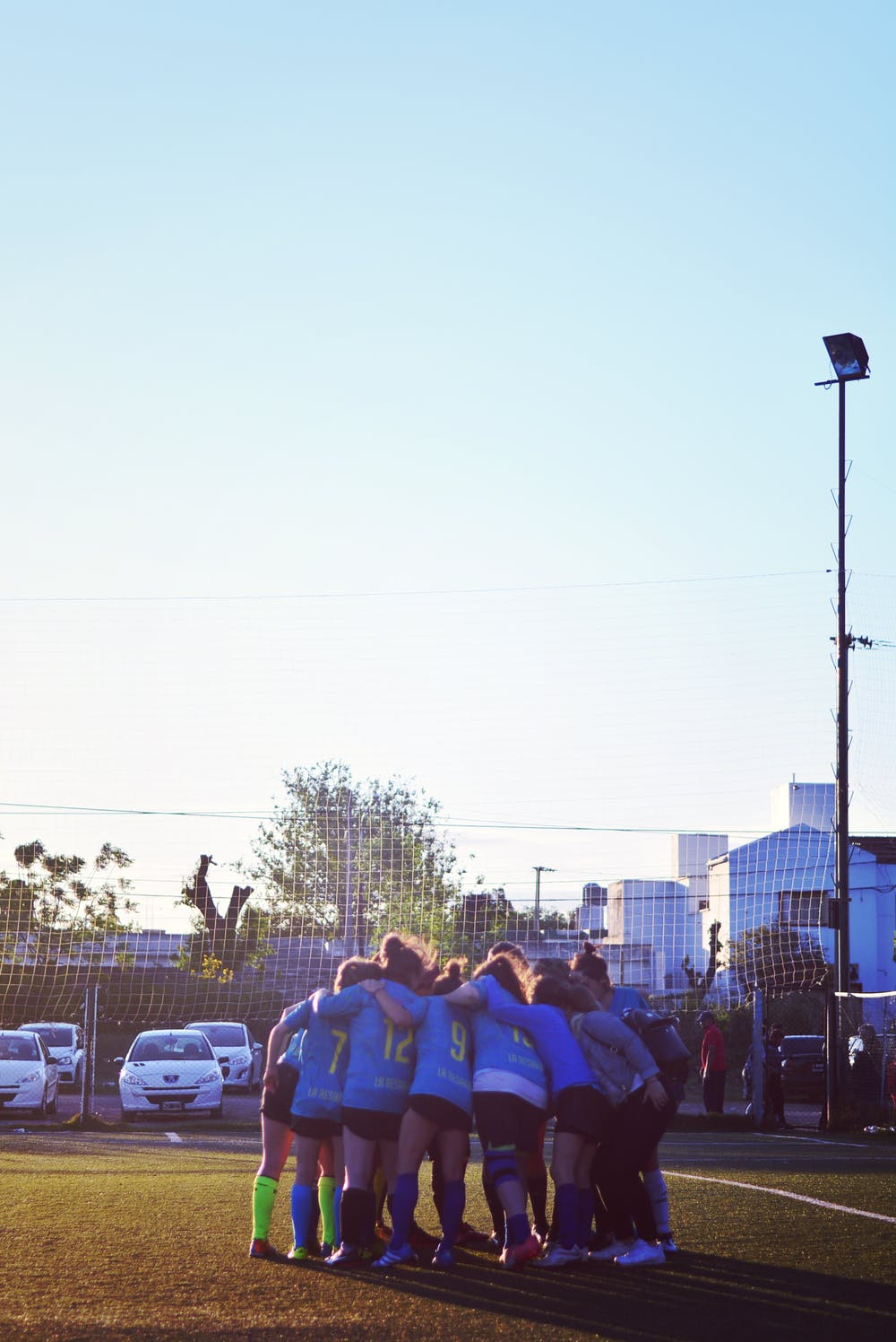 Soccer Team Hugging Eachother