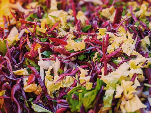 Salad with colorful cabbage and arugula