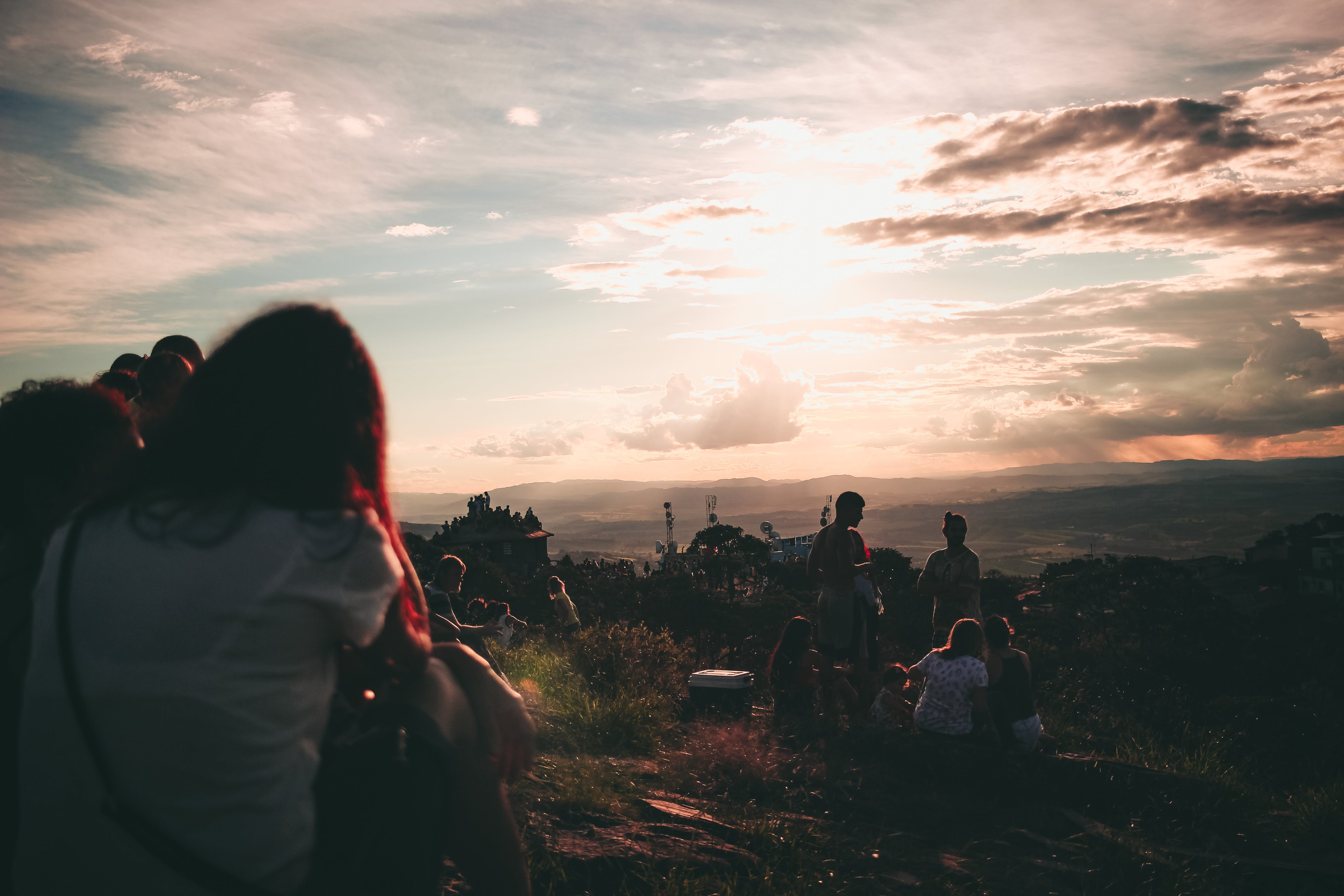 Silhouette Photography of People Gathering during Sunset