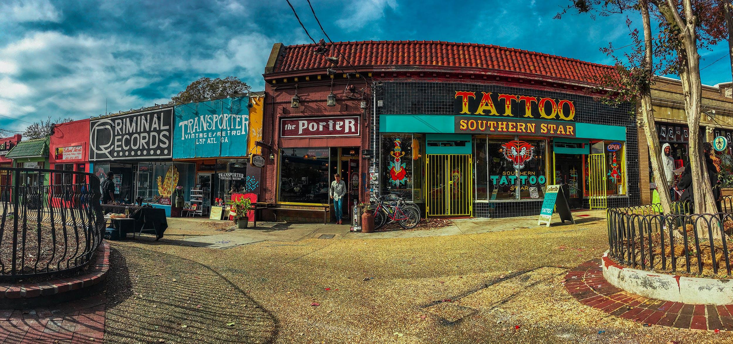 Free stock photo of sidewalk, vintage, shops, blue sky