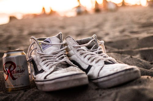 White High-top Vans Sneakers And Tin Can