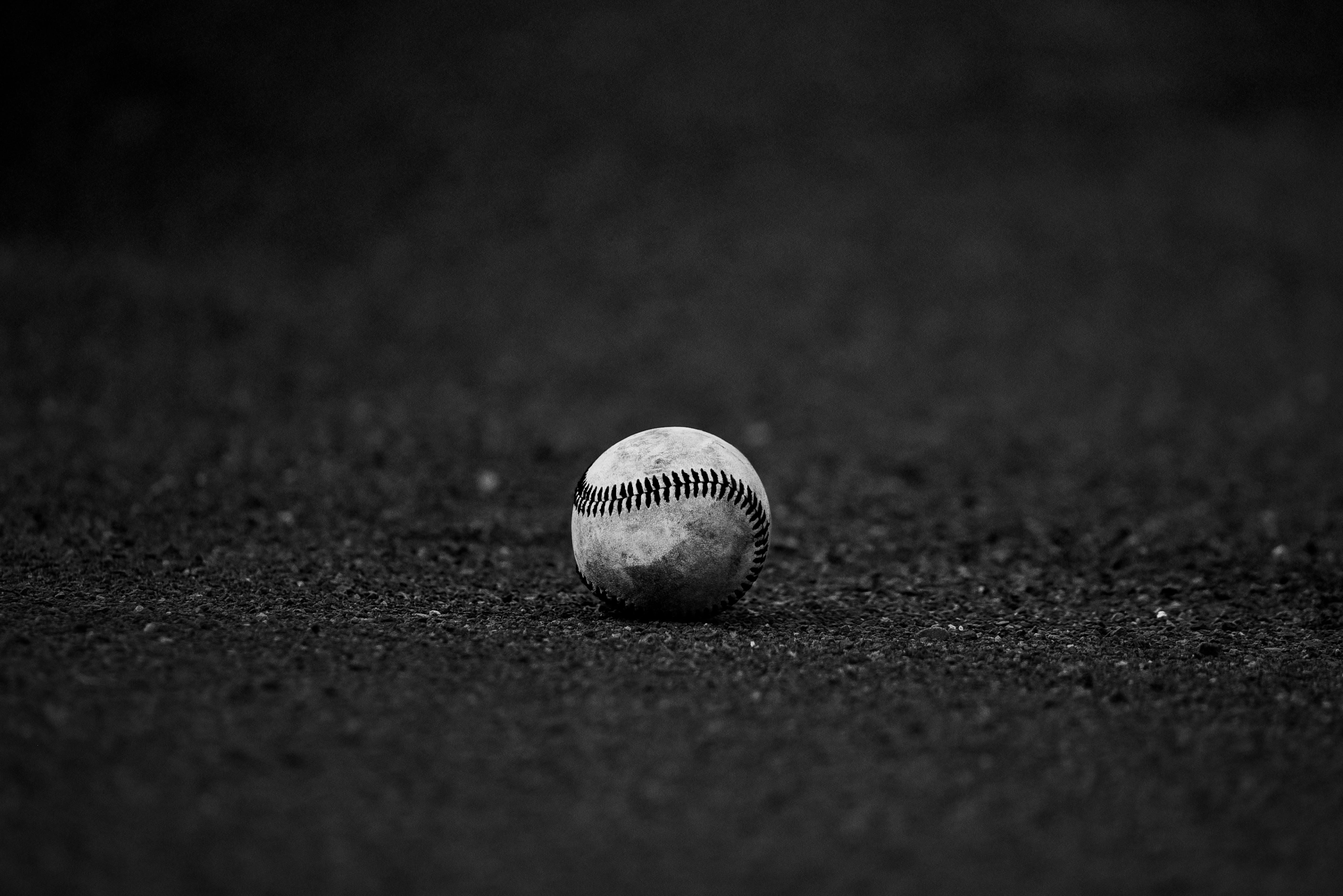 Selective Focus Grayscale Photography of Baseball