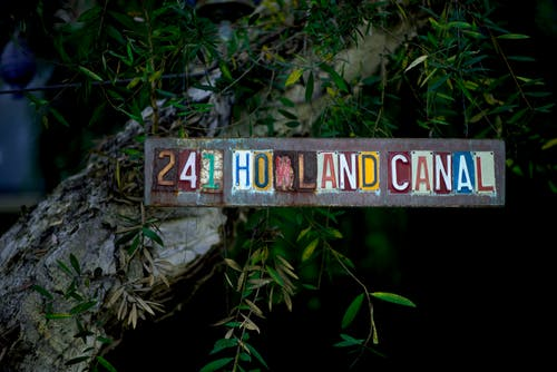Multi-colored 241 Holland Canal Signage Mounted on Rock