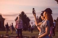 Woman Wearing Grey T-shirt Taking A Photo