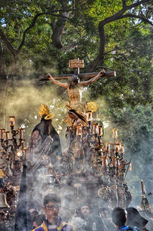 People in Front of a Crucifix