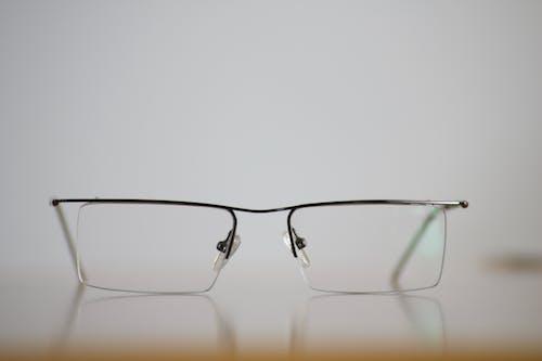 Бесплатное стоковое фото с линза, очки, размытый, снимок крупным планом