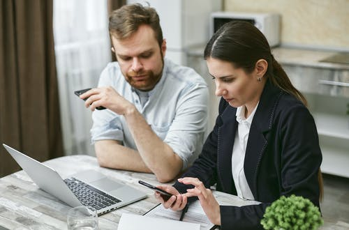 Man and Woman Using a Smartphone