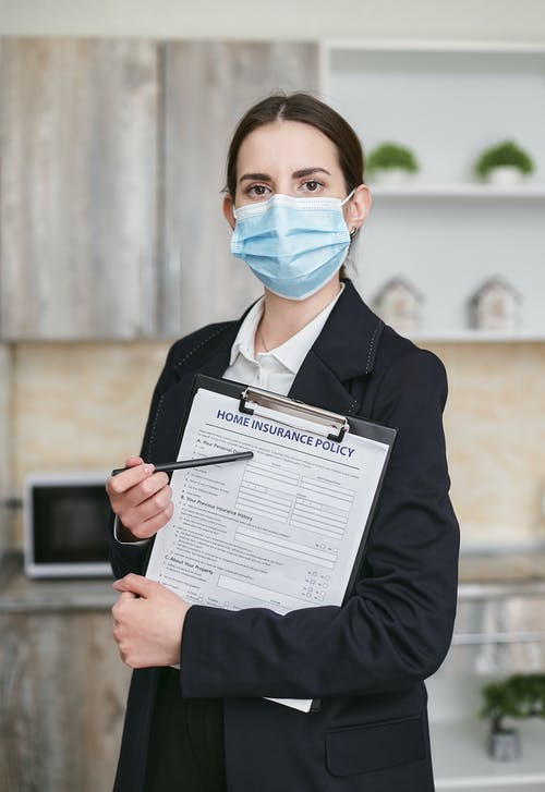 Woman in Black Suit Holding White Printer Paper