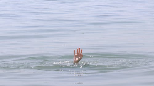 Person's Hand Above Water