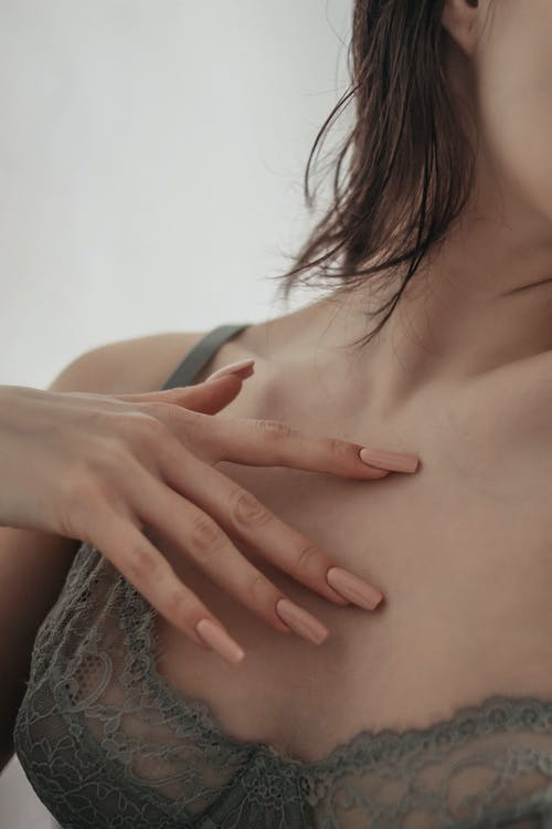 A Close-Up Shot of a Woman Wearing a Gray Brassiere