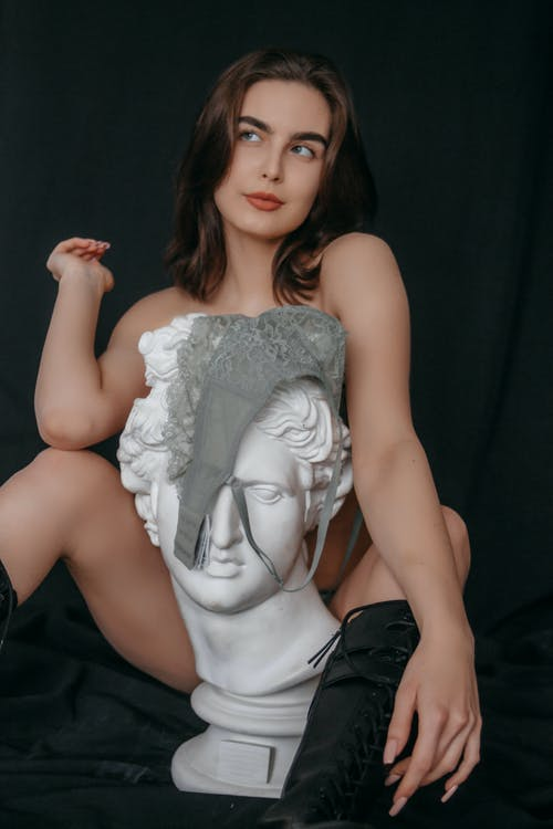 A Bust in front of a Topless Woman