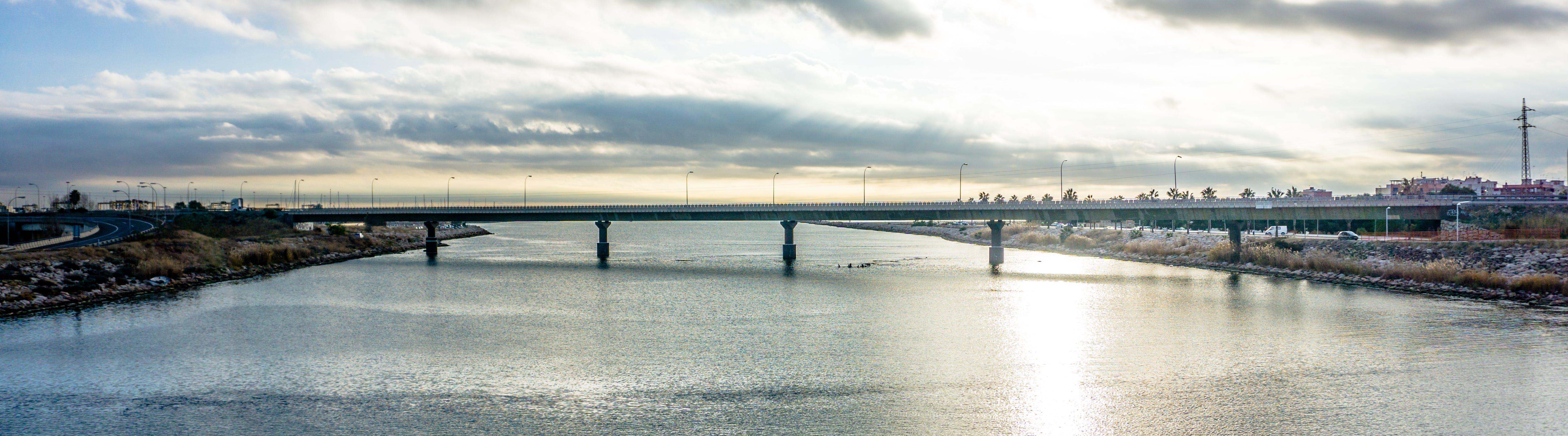 Panoramic Photography of Bridge Under Cloudy Sky
