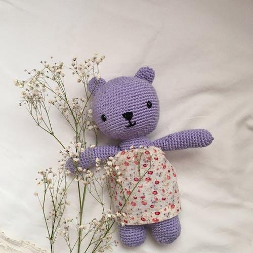 Purple Teddy Bear Stuffed Toy Near Babys Breath Flowers