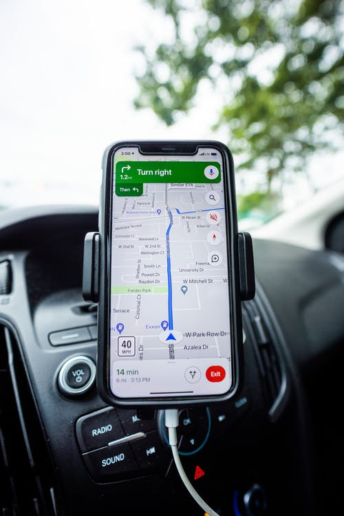 Cellphone on a Stand With Navigation Map Application Open