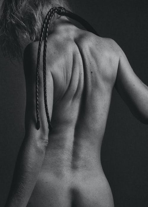 Back View Of Naked Woman In Grayscale