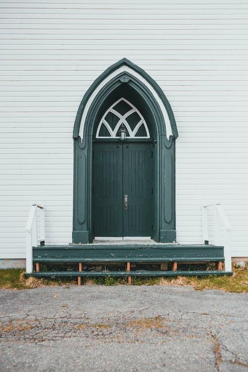 An Exterior of a Green Door
