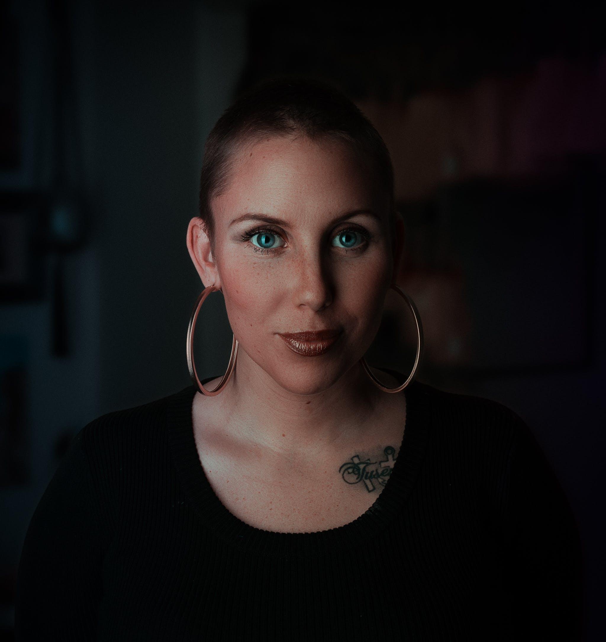 Woman Wearing Earrings and Black Shirt