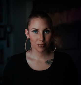 Woman Wearing Earrings and Black Shirt