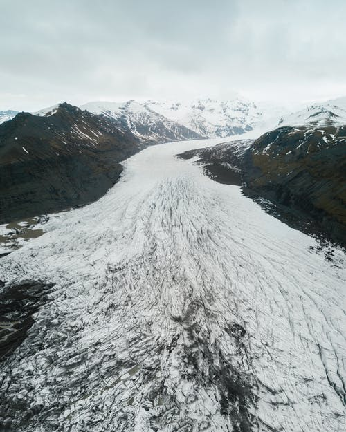 Aerial View Of Snow Covered Path And Mountains