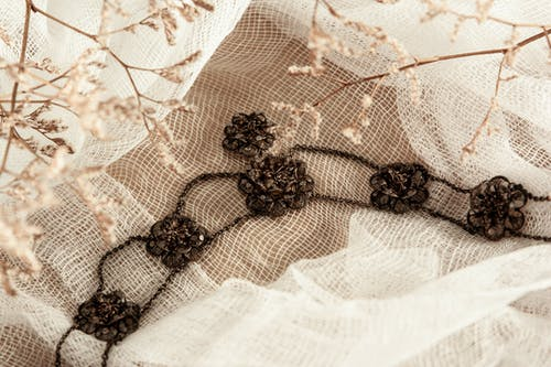 Brown Floral Ornament on White Weave Fabric