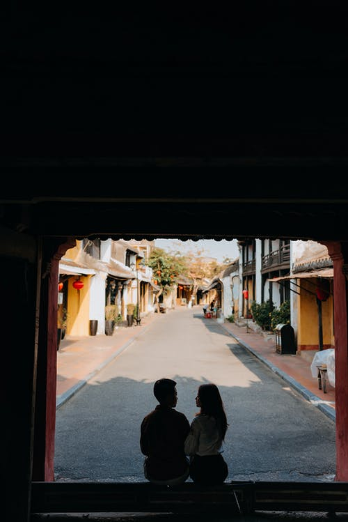 Silhouette of enamored couple looking at each other in doorway of house
