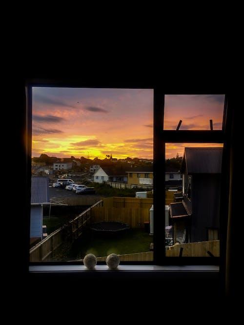 Foto stok gratis bingkai foto, bingkai jendela, bingkai jendela matahari terbenam