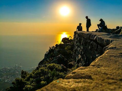 Three Men On Mountain Cliff