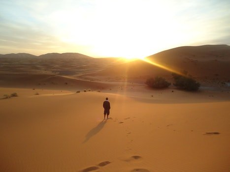 Photo Of Man On The Dessert During Daylight