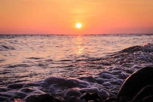 Sea Foam Under Orange Sky