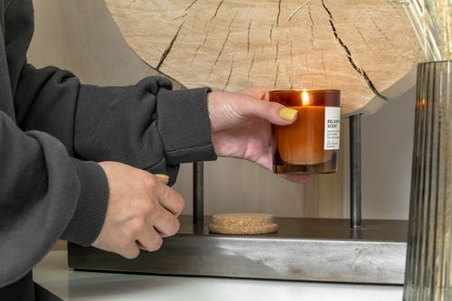 Person Holding Burning Candle
