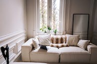 White Sofa Chair Beside Window