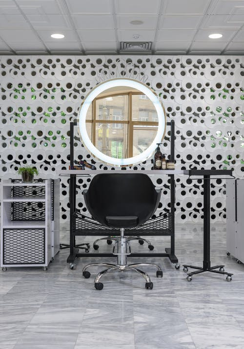 Black Rolling Chair Near White and Black Table