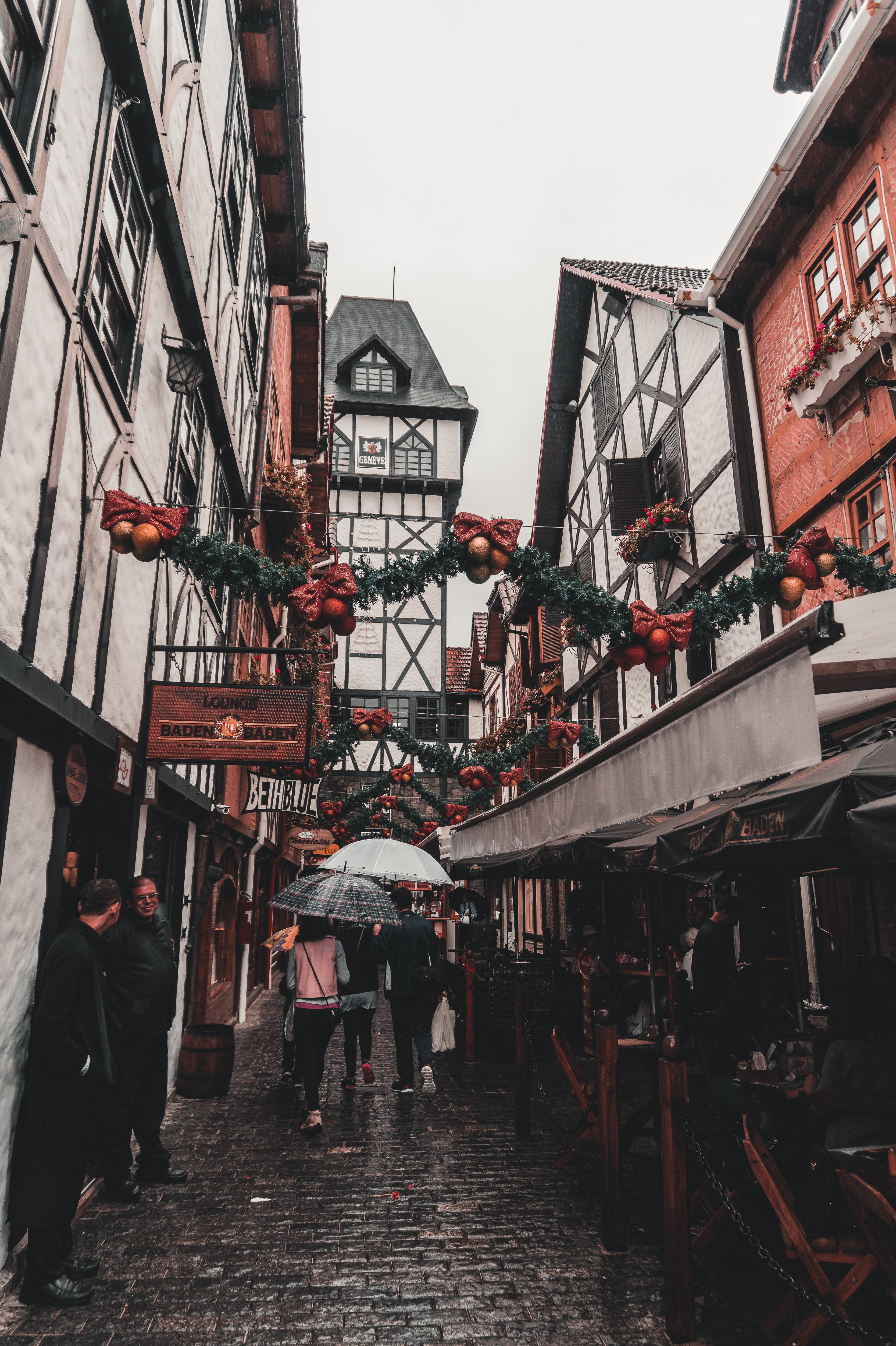 Photo of People Walking Across the Alley