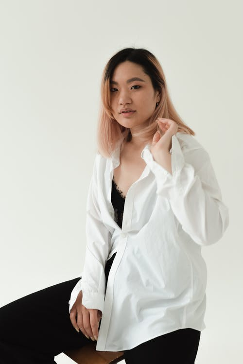 Photo of a Beautiful Woman in a White Dress Shirt Looking at the Camera