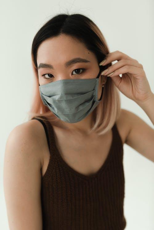 Gratis stockfoto met aan hebben, Aziatische vrouw, dragen